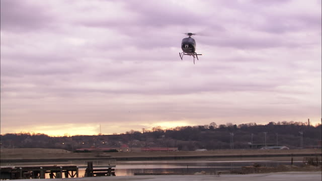 a traffic helicopter lands at a heliport. - helipad stock videos & royalty-free footage