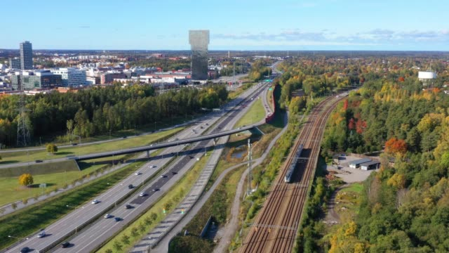 traffic highway intersection, railway, kista - sollentuna, stockholm - rail transportation stock videos & royalty-free footage