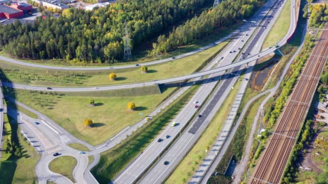 traffic highway intersection, railway, kista - sollentuna, stockholm - roundabout stock videos & royalty-free footage