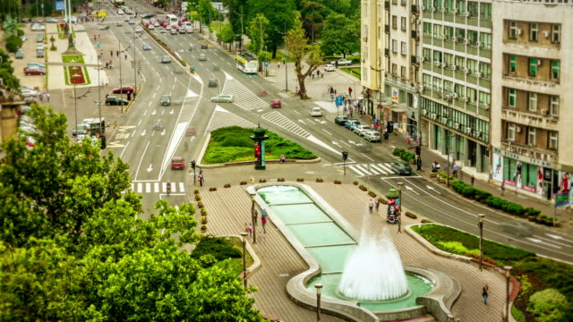 traffic in a city square - belgrade serbia stock videos and b-roll footage
