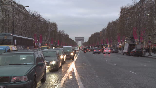 WS Traffic in Avenue des Champs Elysees at Christmas time / Paris, Ile de France, France