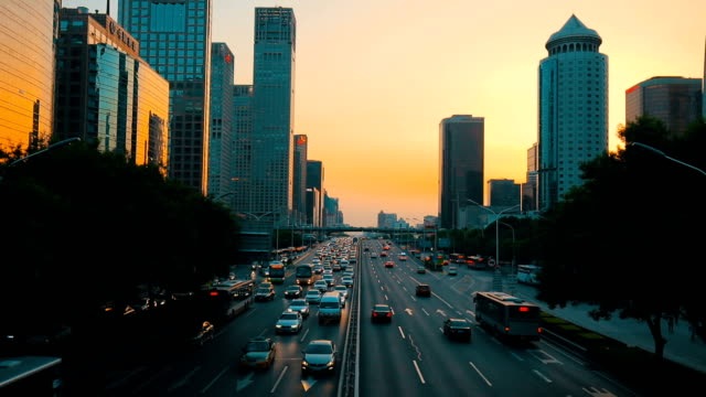 traffic in beijing cbd at sunset,china - beijing stock videos & royalty-free footage