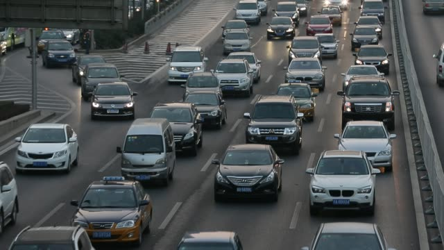 traffic in beijing rush hour at beijing guomao cbd area on november 28 2014 - smog stock videos & royalty-free footage