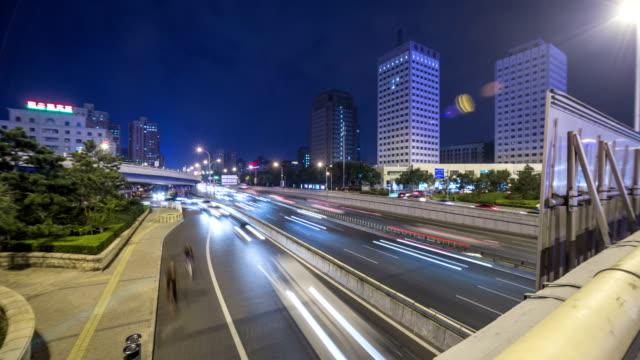 traffic in beijing xizhimen, a landmark of beijing city - 乗り物の明かり点の映像素材/bロール