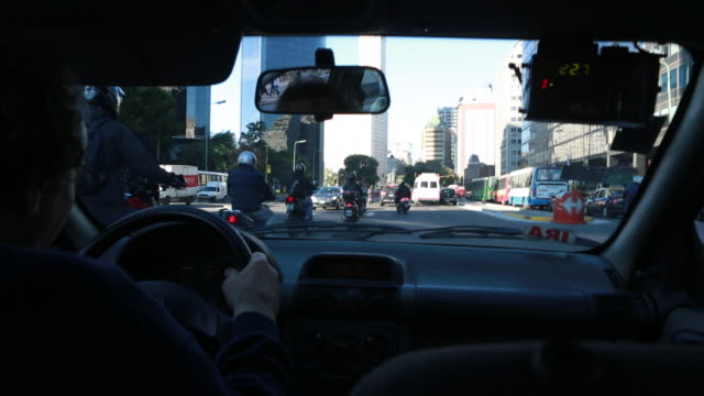 traffic in buenos aires - taxi driver stock videos and b-roll footage