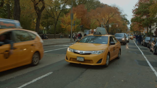 traffic in central park new york city at autumn - taxi stock videos & royalty-free footage