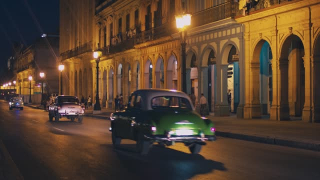 traffic in centre of havana at night, cuba - cuba video stock e b–roll