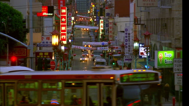 ws, traffic in chinatown at dusk, san francisco, california, usa - chinatown stock videos & royalty-free footage