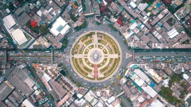 traffic in city aerial view - roundabout stock videos and b-roll footage