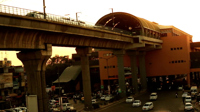 traffic in city over metro train line - delhi stock videos & royalty-free footage