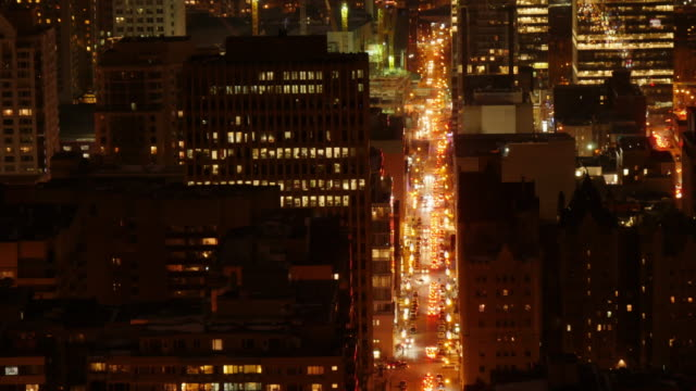 traffic in downtown monteal at night. time lapse from above - vieux montréal stock-videos und b-roll-filmmaterial