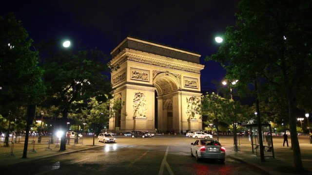 WS Traffic in front of Arc De Triomphe at night / Paris, France