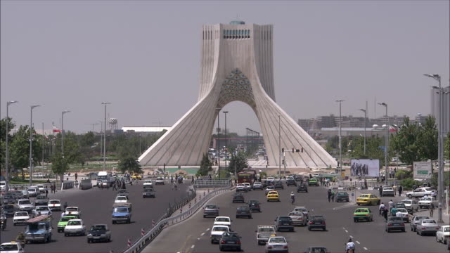 ws ha traffic in front of azadi tower (freedom tower), tehran, iran - tehran stock videos and b-roll footage