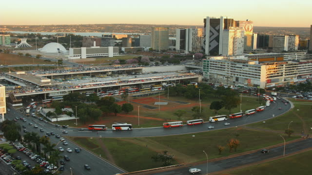 t/l, ws, ha, traffic in front of bus station, day to dusk, brasilia, brazil - brasilia stock videos and b-roll footage