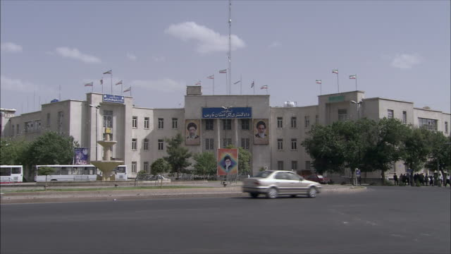 ws traffic in front of government building, shiraz, iran - government building stock videos & royalty-free footage