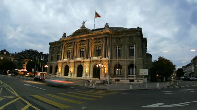 T/L WS Traffic in front of Grand Theatre de Geneve, day to night, Geneva, Switzerland