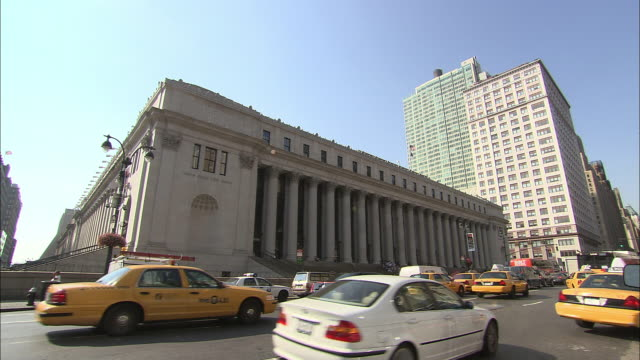 ms, traffic in front of james a. farley building (u.s. general post office), manhattan, new york city, new york, usa - post office stock videos and b-roll footage