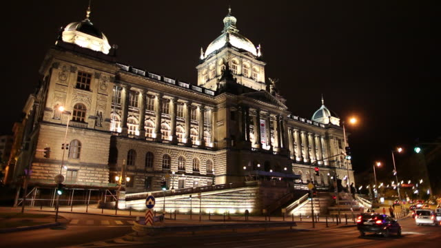 ws traffic in front of national museum illuminated at night / prague, czech republic - czech culture stock videos and b-roll footage