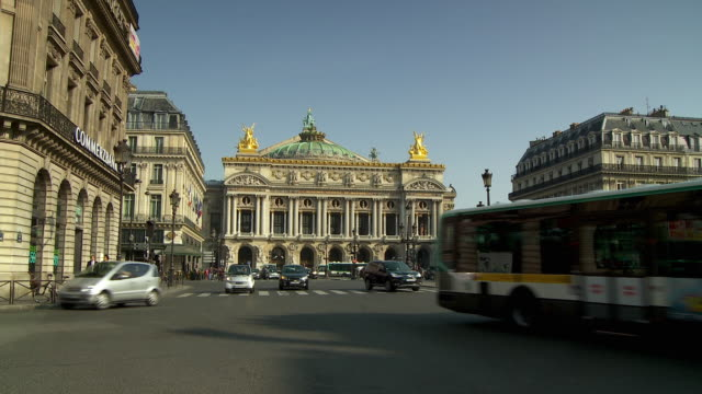 ws traffic in front of national music academy, place de l'opera, paris, france - place de l'opera stock videos and b-roll footage
