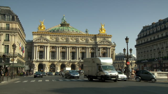 ms traffic in front of national music academy, place de l'opera, paris, france - place de l'opera stock videos and b-roll footage