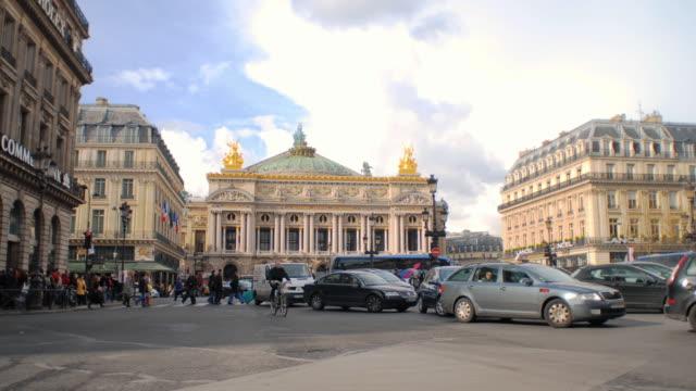 t/l ws traffic in front of opera garnier at place de l'opera / paris, france - place de l'opera stock videos and b-roll footage