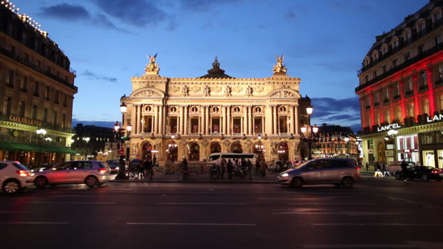 ws traffic in front of opera house at sunset / paris, france - 19th century style stock videos & royalty-free footage