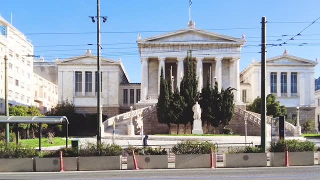 traffic in front of the building of the national library in athens, greece - greece stock videos & royalty-free footage