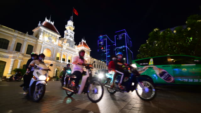traffic in front of the city hall in ho chi minh city (saigon), vietnam. - vietnam stock videos & royalty-free footage