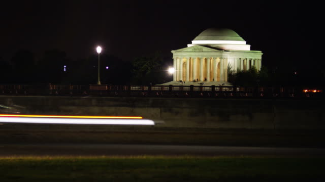 T/L WS Traffic in front of Thomas Jefferson Memorial illuminated at night, Washington D.C, USA