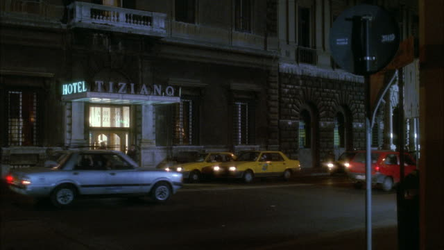 ms  traffic in front of tiziano hotel in rome city street - 1992 stock-videos und b-roll-filmmaterial