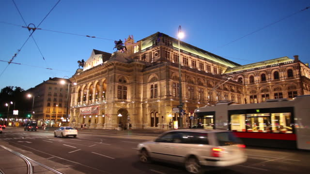 ws traffic in front of vienna state opera at dusk / vienna, austria - traditionally austrian stock videos and b-roll footage