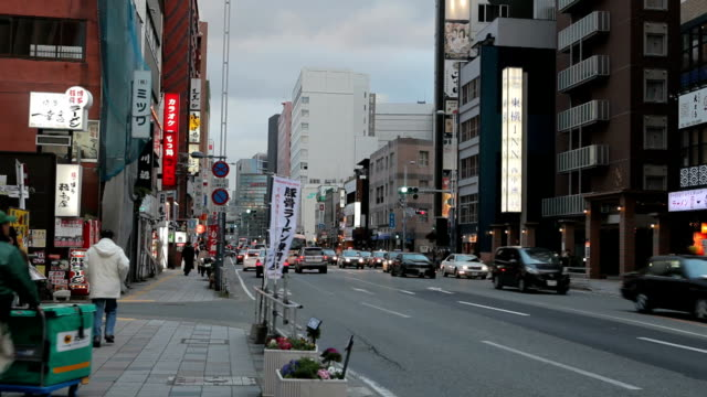 traffic in fukuoka city, japan - fukuoka prefecture stock videos and b-roll footage