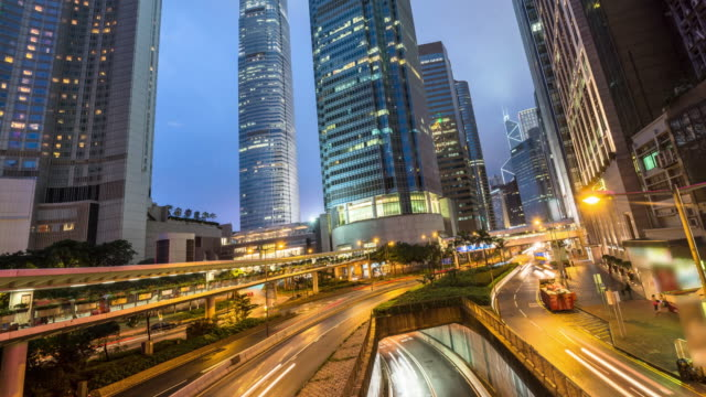 traffic in hong kong,time lapse 4k panning right. - central district hong kong stock videos and b-roll footage