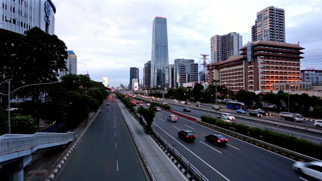 traffic in jakarta business district in indonesia capital city - newly industrialized country stock videos and b-roll footage