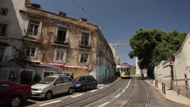 ws traffic in narrow street / lisbon, portugal - narrow stock videos and b-roll footage