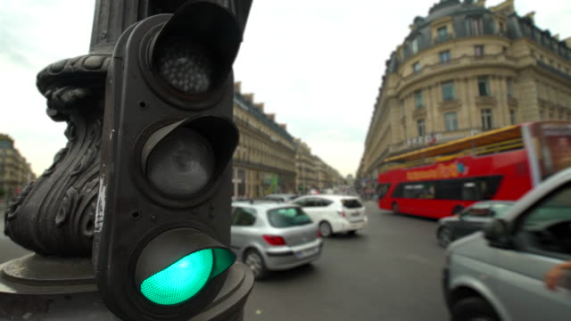 traffic in paris, time lapse - traffic light stock videos & royalty-free footage