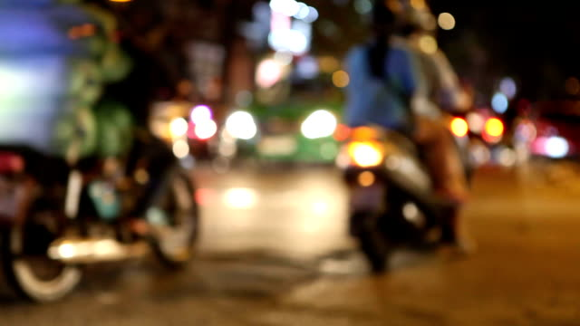 traffic in saigon streets at night - motorino video stock e b–roll