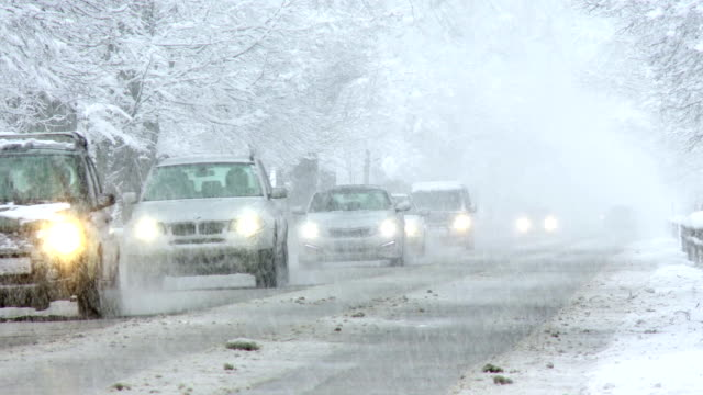 traffic in the snow storm - slush stock videos and b-roll footage