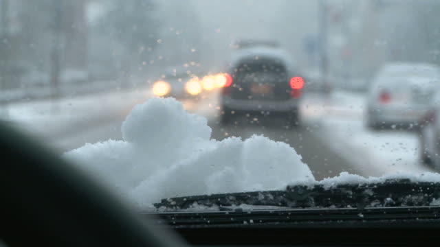 hd: traffic in the snow - windshield stock videos & royalty-free footage