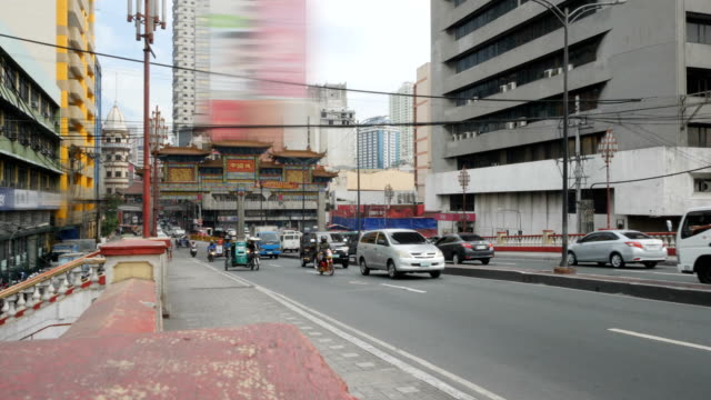 traffic in the streets of manila, philippines - tricycle stock videos & royalty-free footage