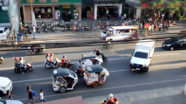 traffic in the streets of philippines - tricycle stock videos & royalty-free footage