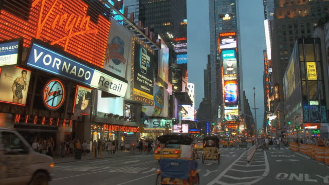 ws traffic in times square at dusk / new york city, usa - rickshaw stock videos and b-roll footage