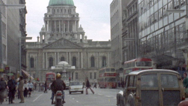 vídeos de stock, filmes e b-roll de 1973 montage traffic in ulster showing the belfast city hall before the election / northern ireland - 1973