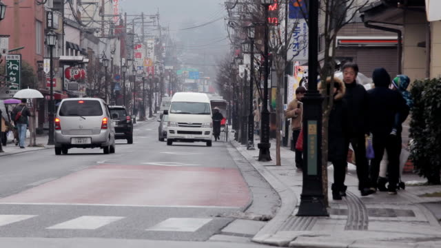 traffic in yufuin city, japan - oita prefecture stock videos & royalty-free footage
