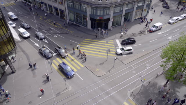 traffic intersection at the famous and expensive bahnhofstrasse in zuerich - urban road stock videos & royalty-free footage
