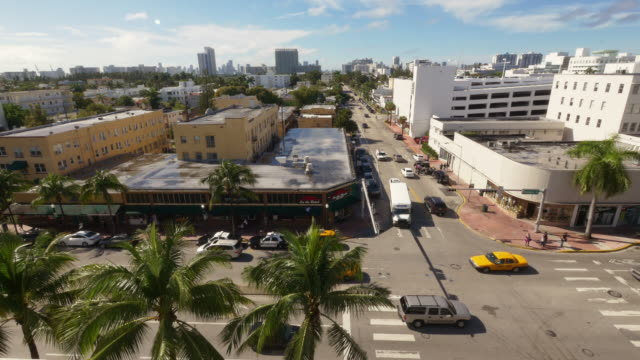 traffic intersection in miami beach -south beach at washington ave. wide shot from above - spoonfilm stock-videos und b-roll-filmmaterial