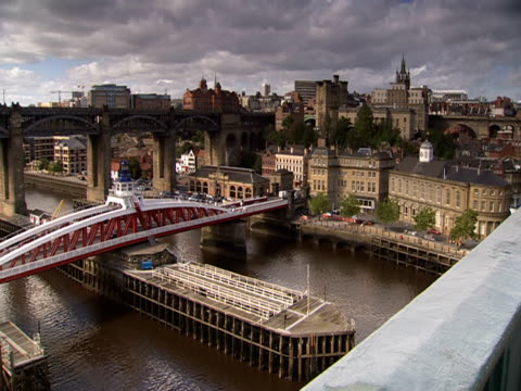 traffic is crossing the swing bridge over the river tyne. - swing bridge stock videos & royalty-free footage