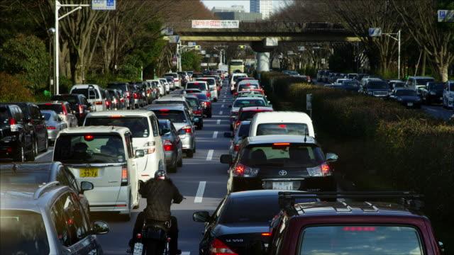 traffic jam along inokashira dori, in tokyo - stau stock-videos und b-roll-filmmaterial