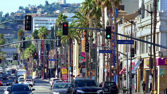 traffic jam and congestion during morning rush hour on hollywood boulevard near oscar landmark dolby theater in los angeles, california, 4k - the dolby theatre stock videos & royalty-free footage