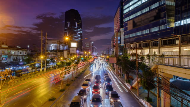 traffic jam and new provincial electricity authority (pea) building background. annually an estimated 150,000 cars join the heavily congested streets of the thai capital. - bridge built structure stock videos & royalty-free footage